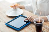 fast food, people, technology and diet concept - close up of woman with tablet pc computer, pizza and cola counting calories at table poster