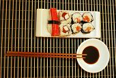 Seafood traditional sushi and rolls on the white dish. poster