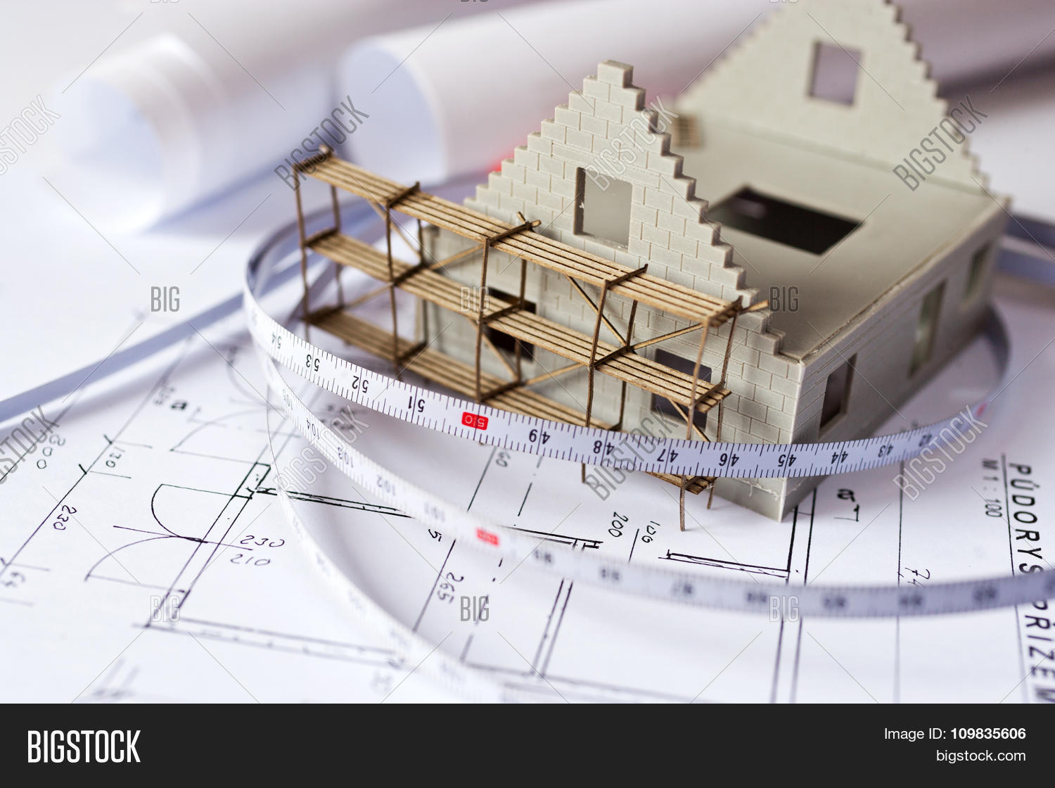 New model house image photo free trial bigstock new model house with scaffolding on architecture blueprint plan at desk construction site malvernweather Image collections