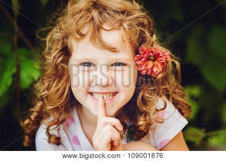 Beautiful Little Girl Putting Finger Up To Lips And Ask Silence. Toning Photo.