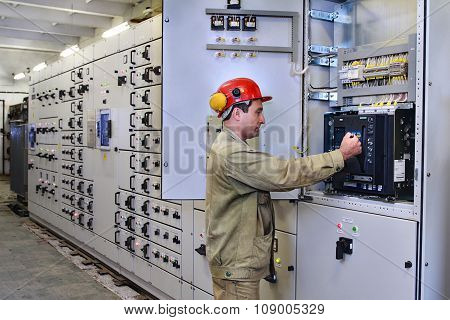 Electrical Engineer Uses Equipment Of The Switchboard.