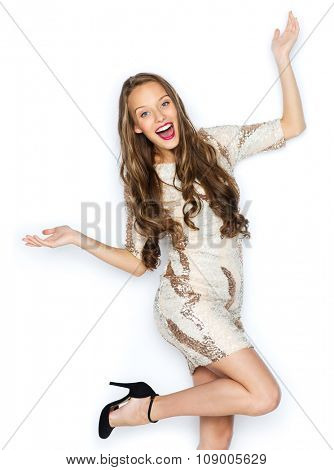 people, style, holidays, hairstyle and fashion concept - happy young woman or teen girl in fancy dress with sequins and long wavy hair having fun poster