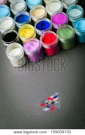 multicolored paint in jars