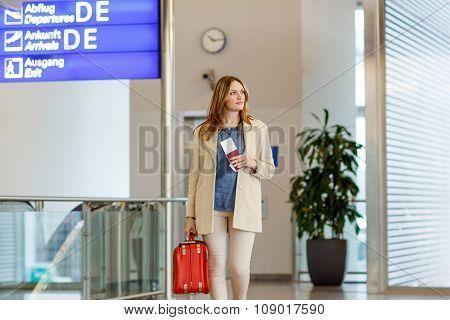 Tired woman at international airport walking through terminal. Annoyed female tourist passenger waiting. Canceled flight due to pilot strike. poster