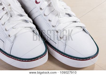 Closeup Of Fashionable Modern Laced Sneakers In White.