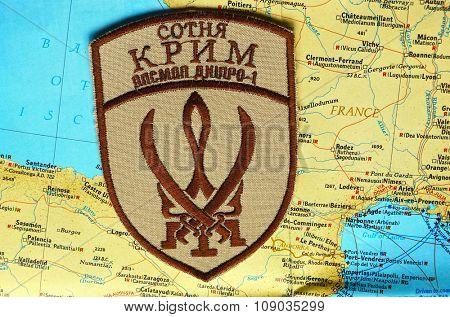 Kiev, Ukraine.NOV 13.Illustrative editorial. Chevron of Islamic extremist formation Crimea as part of Ukrainian Army.Background map  November 13, 2015 in Kiev, Ukraine
