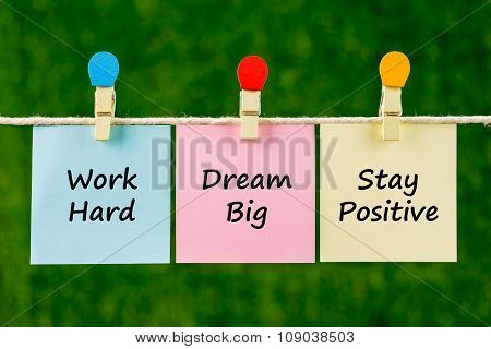 Word Quotes Of Work Hard, Dream Big, Stay Positive On Sticky Color Papers Hanging On Rope.