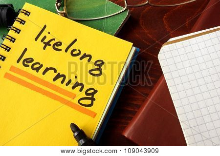Notebook with lifelong learning  sign. Education concept.