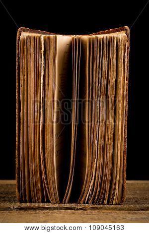 Ancient Book Shot On Black Background