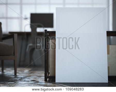White canvas near the table in loft interior.