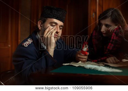 Man and woman in retro style weep over the manuscripts. The main character of the man the woman is blurred in the background. poster