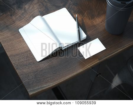 Open blank notebook with black pen.