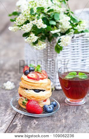 puff pastry with berries and beautiful bouquet of white flowers