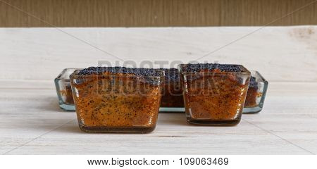 Three Lemon Poppy Cakes On Wooden Plate