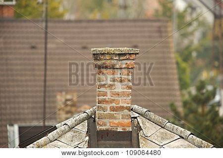 Chimney on a roof of a house