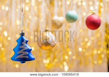 Christmas Ornaments on a golden background a side