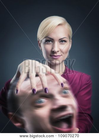 Serious psychic with stressed head in her hand