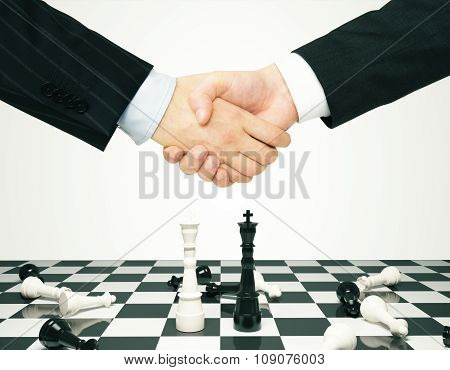 Consensus Concept With Men Shaking Hands And Chess Pawns