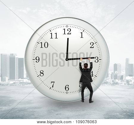 Stop Timing Concept With Businessman Trying To Stop The Time At City Background