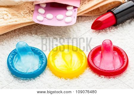 Pills Condoms And Lipstick On Lace Lingerie