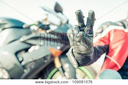 Biker Greeting With The Fingers