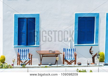 Blue Windows On A White Building In Oia, Santorini