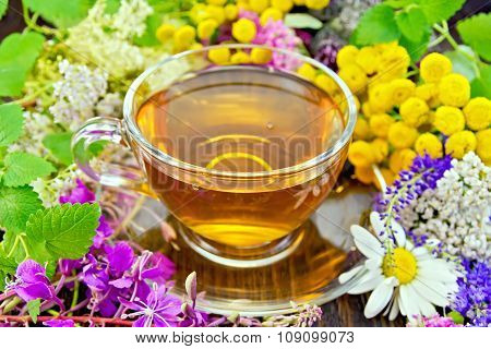 Tea From Flowers In Glass Cup On Dark Board