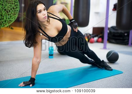 Fit woman doing side plank yoga pose Concept pilates fitness healthy lifestyle