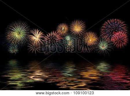 Festive Fireworks Display With Reflections