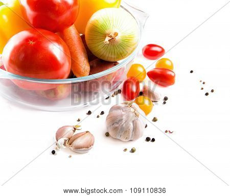 Vegetables In A Glass Pot Isolated On White Background