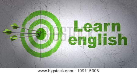 Learning concept: target and Learn English on wall background