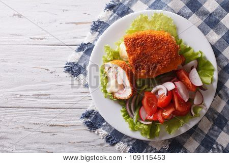 Chicken Schnitzel Cordon Bleu And A Salad. Horizontal Top View