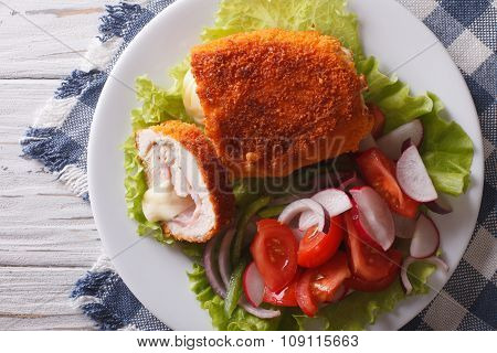 Sliced Chicken Cordon Bleu And Salad Close-up. Horizontal Top View