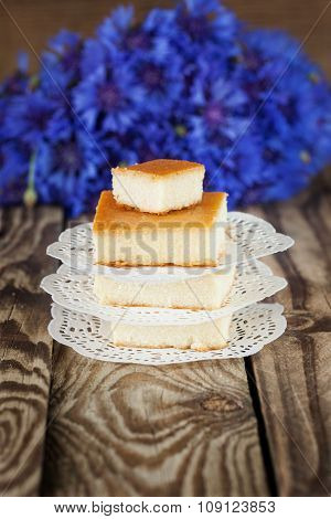Cottage cheese baked pudding, selective focus, with fowers background