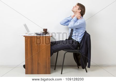 Young Businessman Using Computer Suffering From Neck Ache poster
