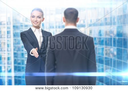 Portrait of handshake gesturing manager with buinessman, blue background. Concept of leadership and success