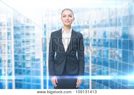 Half-length portrait of smiley businesswoman, blue background. Concept of leadership and success