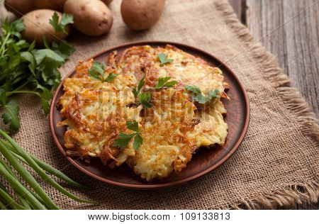 Potato pancakes or latke traditional homemade fried vegetable food recipe. Healthy organic vegan foo