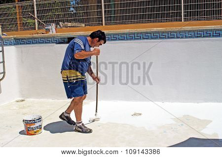 A man painting redone the pool