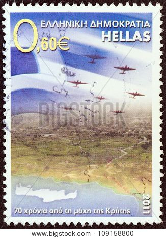 GREECE - CIRCA 2011: A stamp printed in Greece issued for the 70th anniversary of the Battle of Crete shows Greek flag and airplanes over Crete, circa 2011.