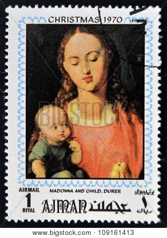 AJMAN - CIRCA 1970: Stamp printed in Ajman shows Madonna and child by Durer circa 1970
