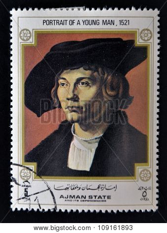 AJMAN - CIRCA 1970: A stamp printed in Ajman shows Portrait of Young Man by Albrecht Durer