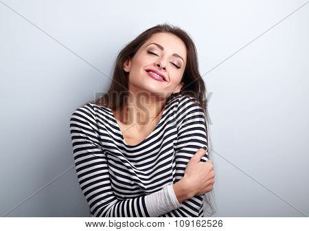Happy Young Casual Woman Hugging Herself With Natural Emotional Enjoying Face. Love Concept By Yours