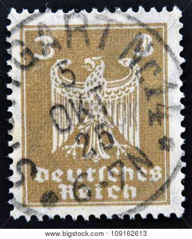 GERMANY - CIRCA 1924: A stamp printed in Germany shows the Eagle coat of arms of Germany circa 1924.