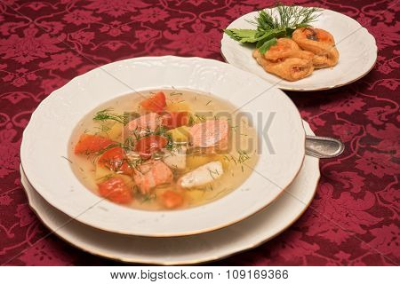 Fish salmon soup in white plate