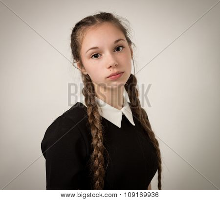 Beautiful Teenage Girl With Plaits Dressed In Black