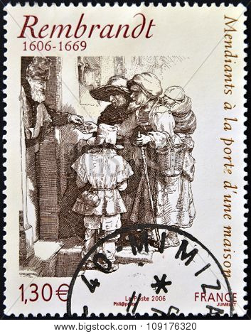stamp printed in France shows Beggars receiving alms at the door of a house by Rembrandt