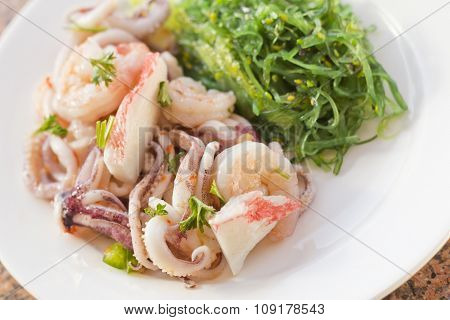 Lobster shrimp and calamari seafood salad with sesame seaweed poster
