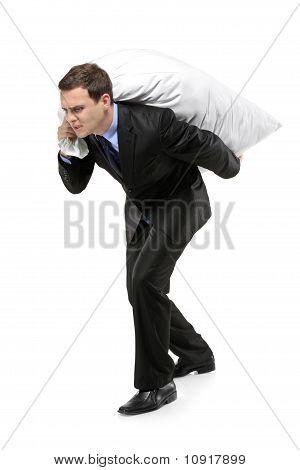 Full Length Portrait Of A Man Carrying A Money Bag