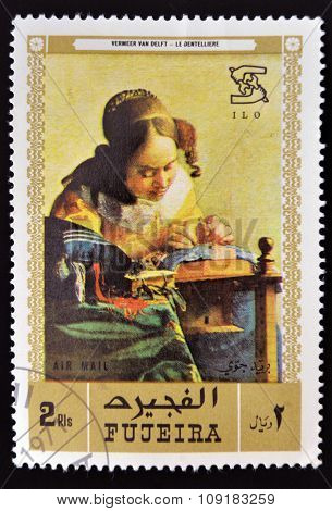 YEMEN - CIRCA 1971: A stamp printed in Fujeira shows The Milkmaid by Johannes Vermeer circa 1968